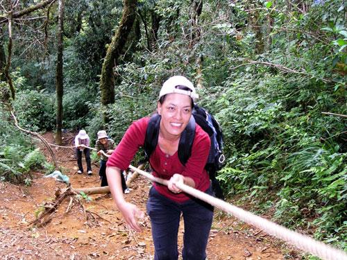 Climbing mount Lang Biang with rope